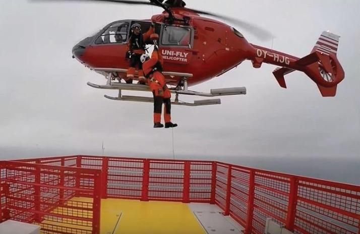 A technician being lowered onto a turbine at Westermost Rough Offshore Wind Farm.