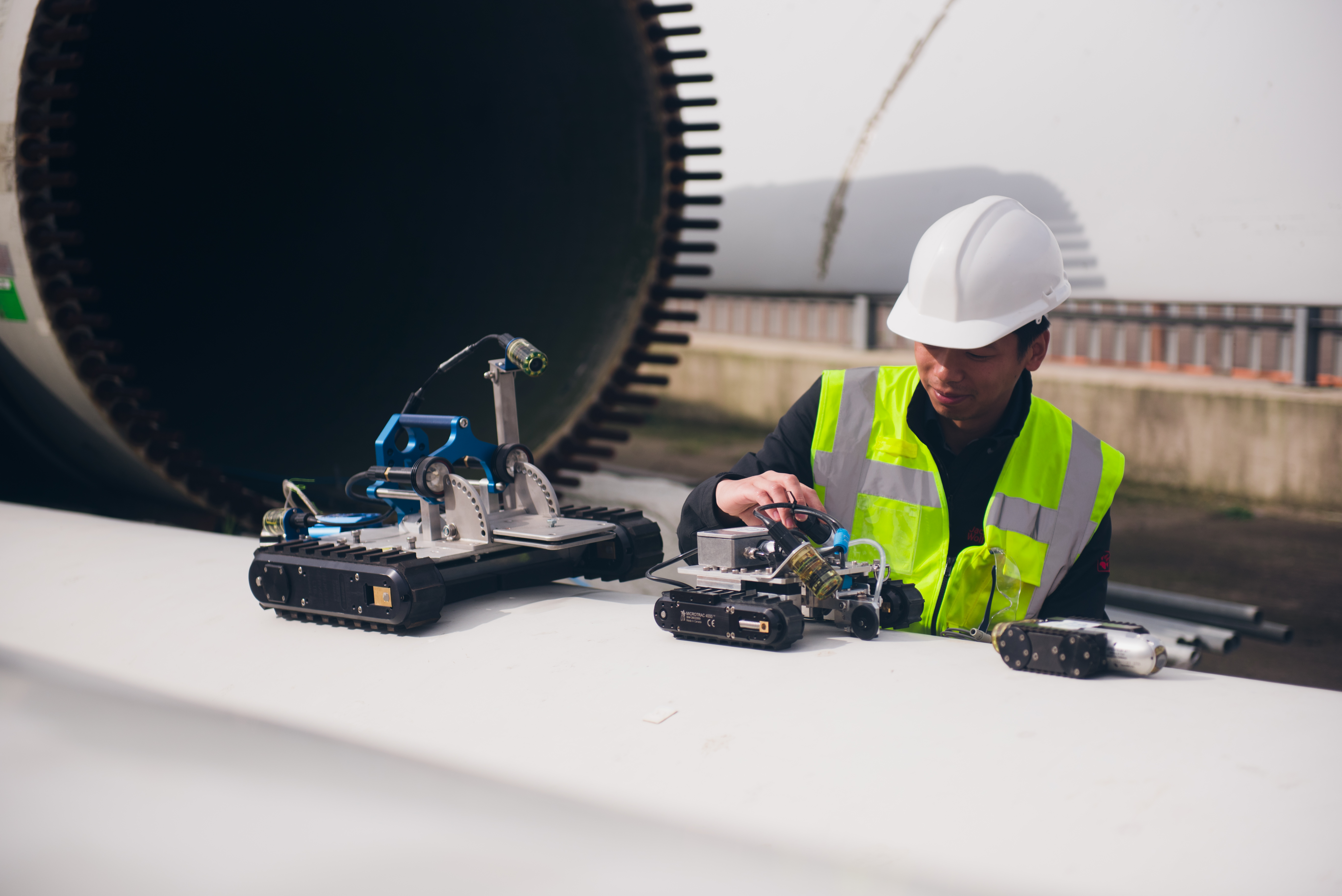 A Catapult engineer inspects ATAM Group's MagTrack robotic crawler before testing at the National Renewable Energy Centre in Blyth.